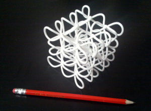 The physical printed 3D knot next to a pencil
